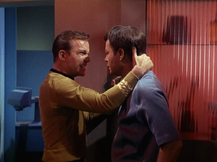 Kirk forcefully grabs McCoy's neck in sickbay