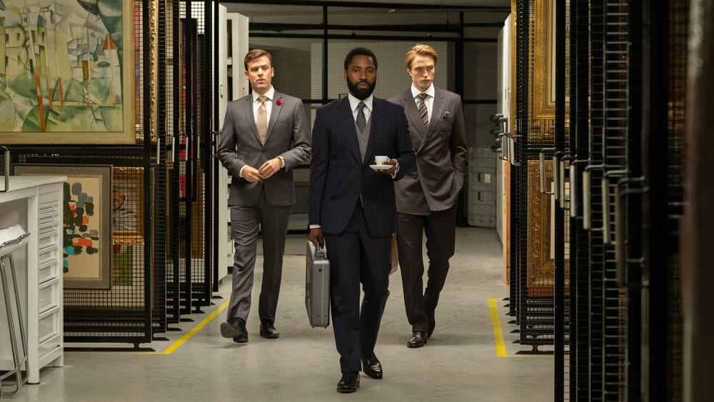 John David Washington and Robert Pattinson are shown through the vaults of a secure facility in Tenet