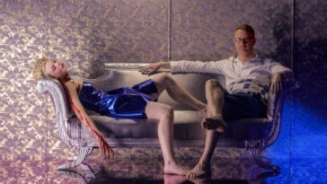 Elle Fanning and Nicolas Winding Refn pose in a promotional still for The Neon Demon