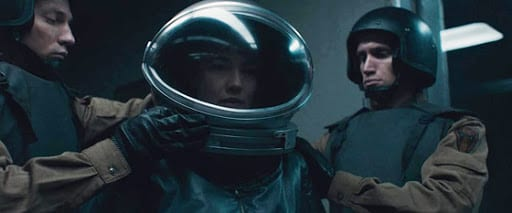Dr. Klimova is prepared in a spacesuit by two Russian soldiers before going in to face the alien