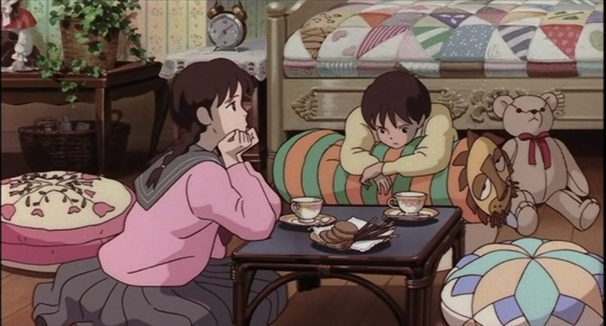 Yuko and Shizuku ponder the facts of life over tea and biscuits
