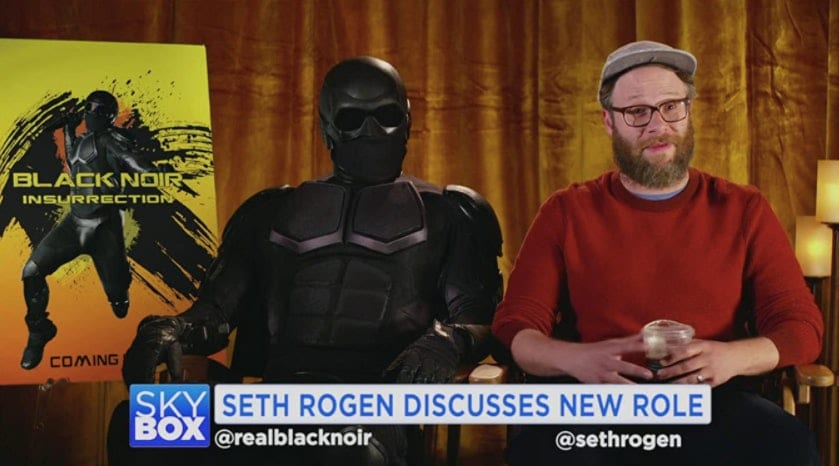 Black Noir sits with Seth Rogen who's talking about his new film