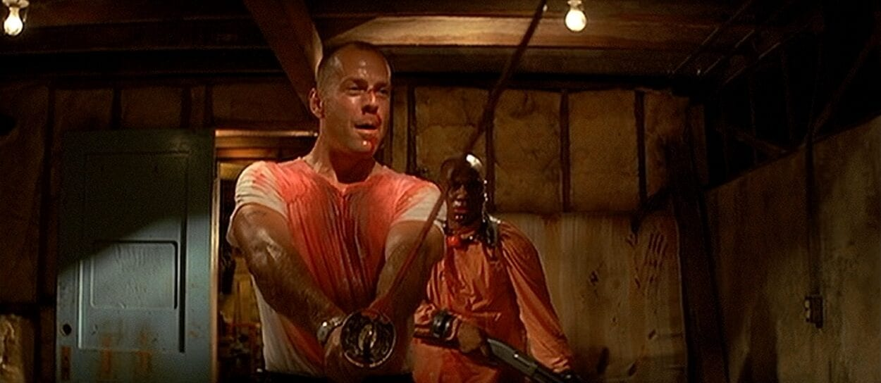 Bloody Bruce Willis holding a samurai sword with Ving Rhames behind him