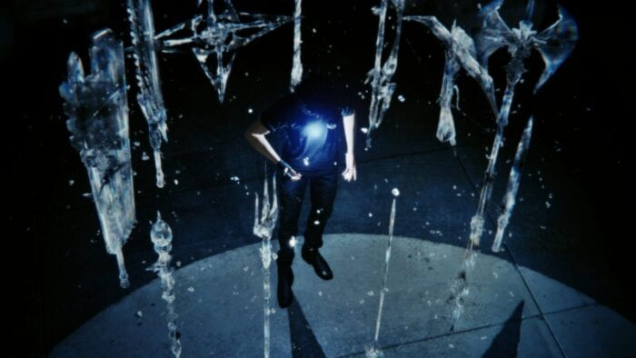 Noctis stands in the middle of projections of the legendary weapons