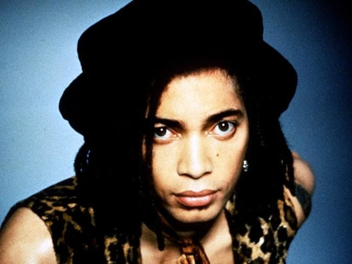 Terence Trent D'Arby wearing a vest and hat
