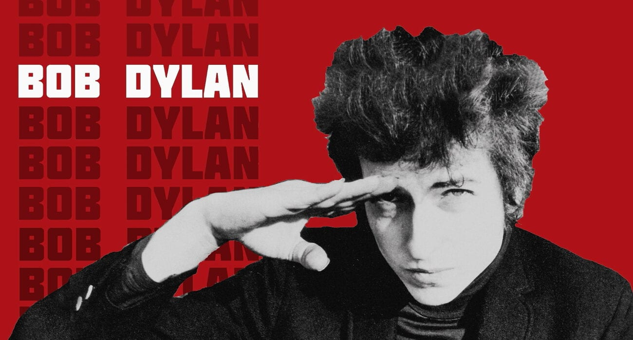 a young Bob Dylan salutes in front of a red backdrop
