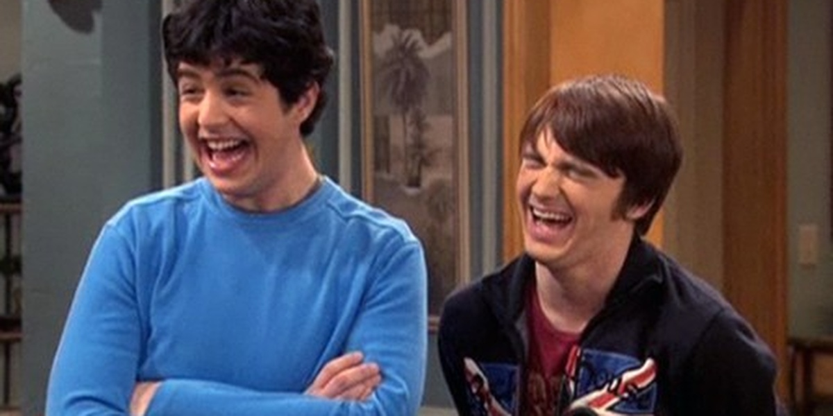 Drake & Josh laughing, Josh with his arms crossed and Drake with his eyes closed