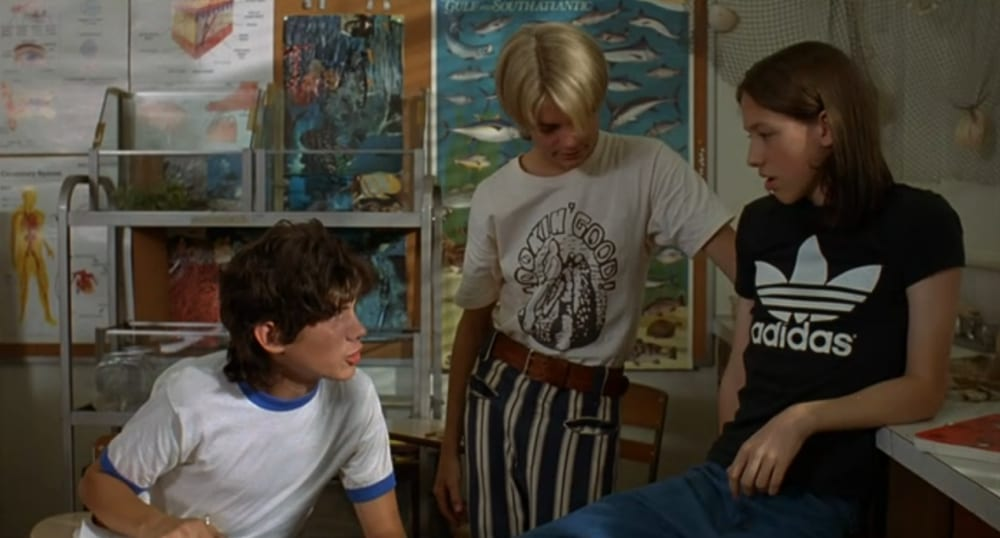 Mitch (right) talks with Tommy and Carl in science class