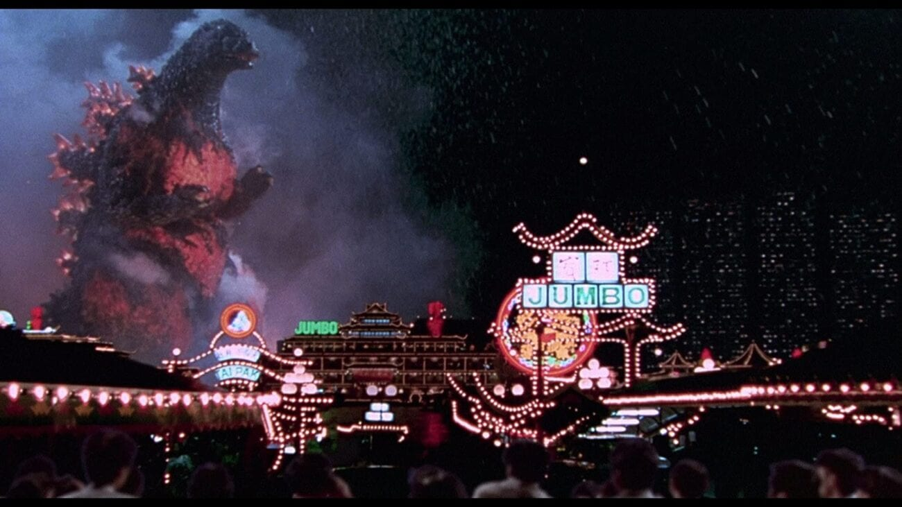 Godzilla stomps through Tokyo's neon buildings, glowing bright orange due to his impending nuclear meltdown.