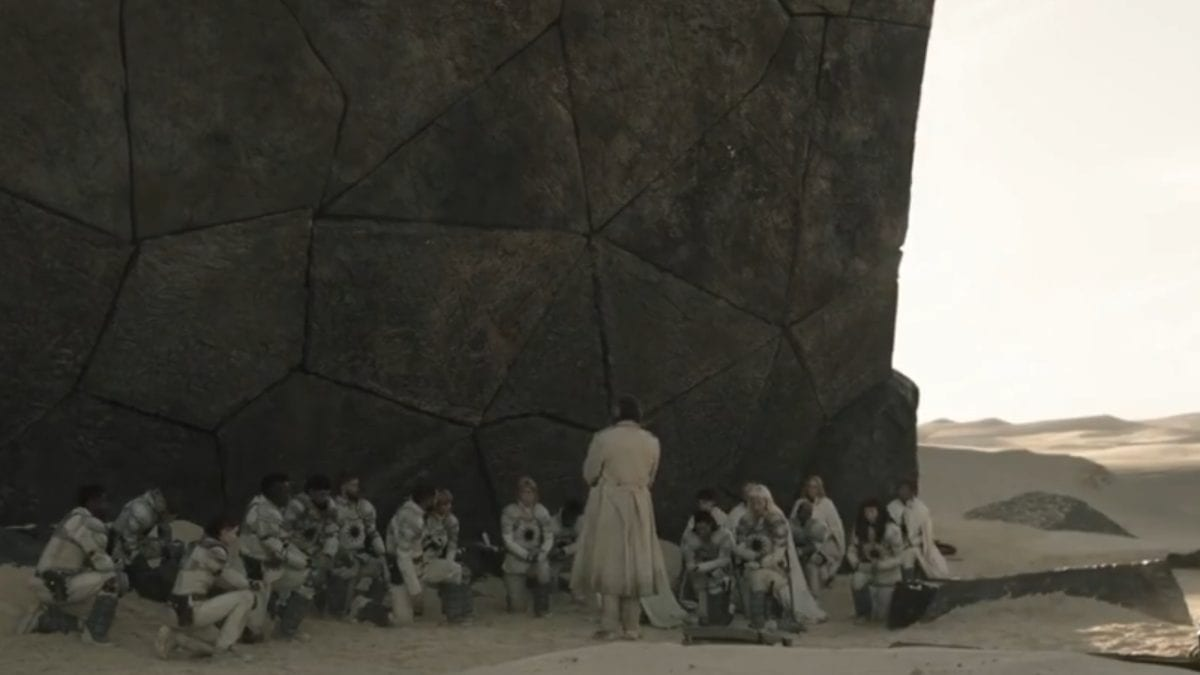 All of the Mithraic survivors kneel before Marcus in the shadow of the artifact