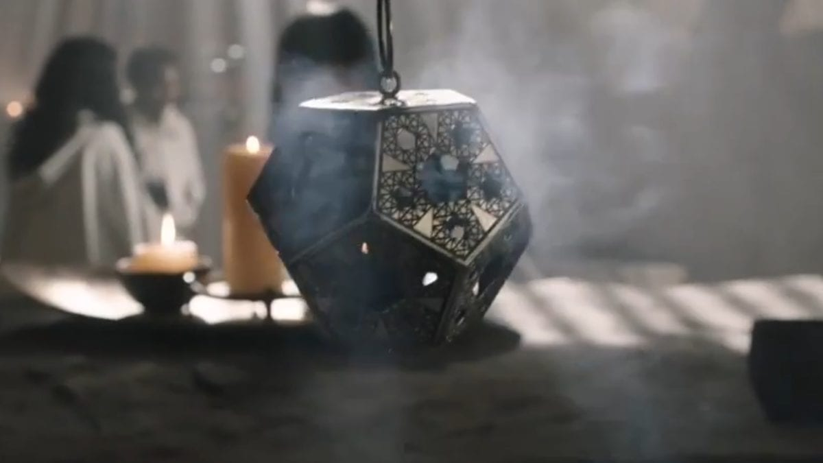 Raised by Wolves - A 12-sided metal brazier hangs from a chain, incense burning inside