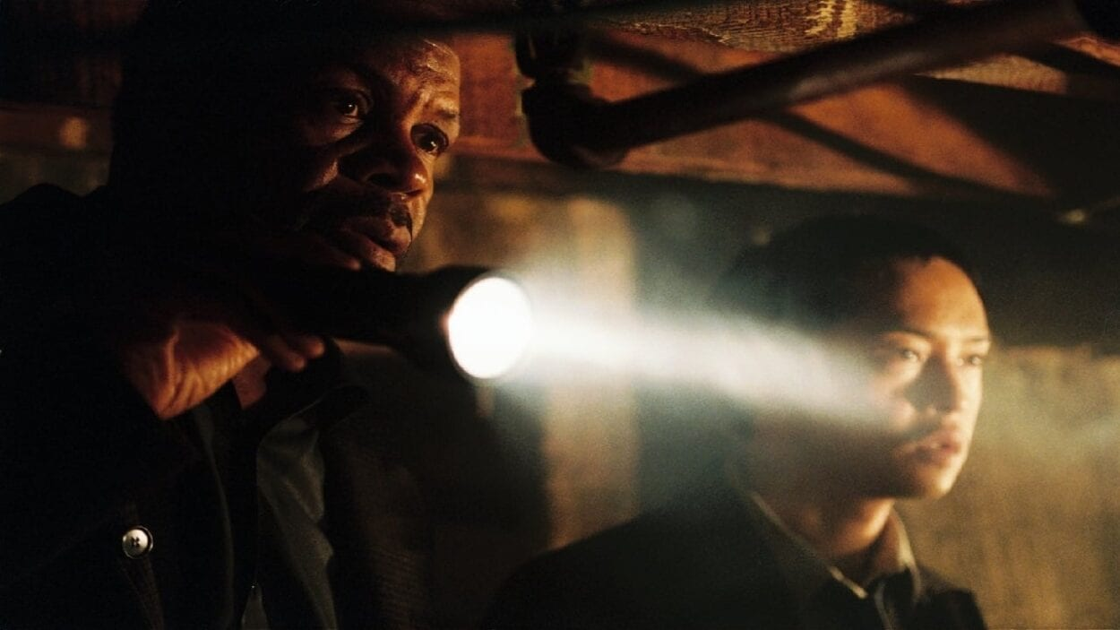 Tapp and Sing use a flashlight at a crime scene inspecting something off-screen.