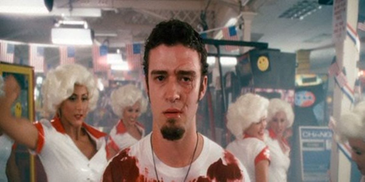 Justin Timberlake as the scarred soldier during the musical hallucination sequence with dancers in Southland Tales