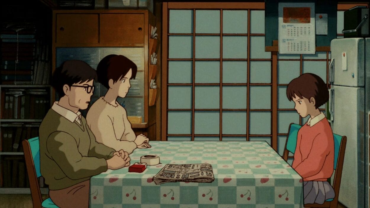 Shizuku discusses her future with her parents at the kitchen table