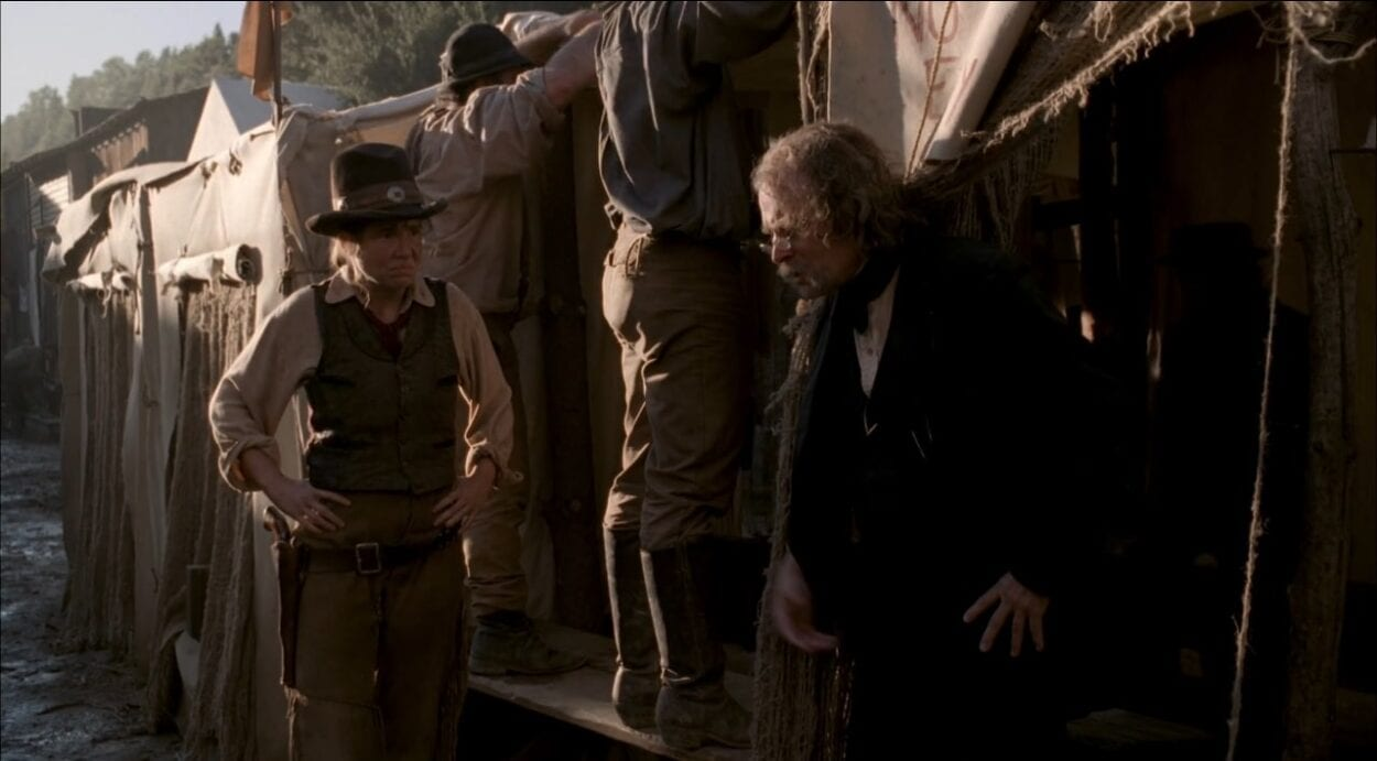 "Doc Cochran (Brad Dourif) welcomes Calamity Jane (Robin Weigert) outside one of the ""pest tents"" in a scene from ""Deadwood"""