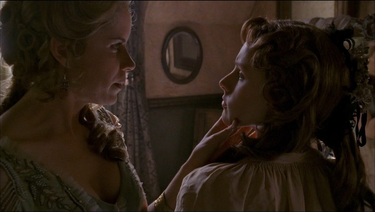 Joanie Stubbs (Kim Dickens) scolds Flora (Kristen Bell) in a scene from Deadwood.