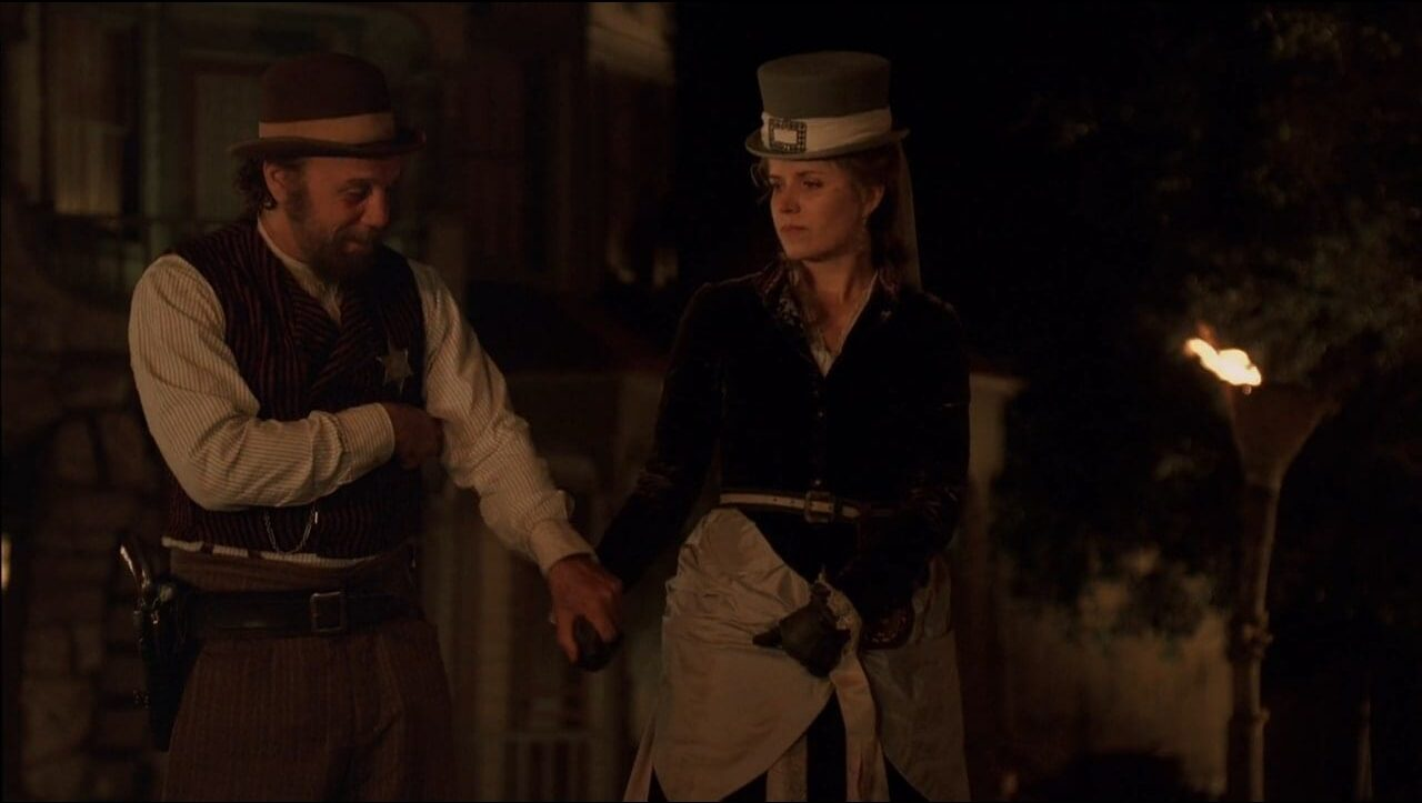 Charlie Utter (Dayton Callie) comforts a distraught Joanie (Kim Dickens) in a scene from Deadwood.