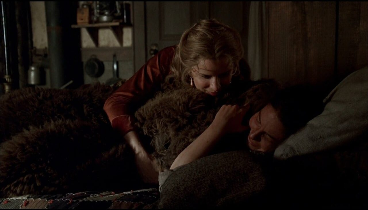 Joanie (Kim Dickens) snuggles with Jane (Robin Weigert).