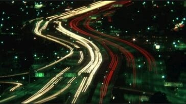 A long-take shot of a freeway with speeding cars being shown in lines of lights