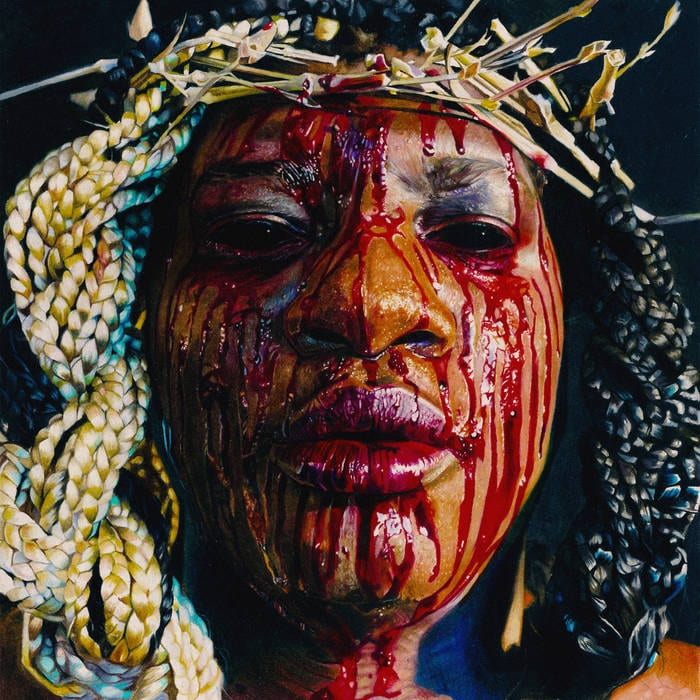 Backxwash Stigmata EP Cover, her covered in blood, with blonde braids and a crown of gold safety pins