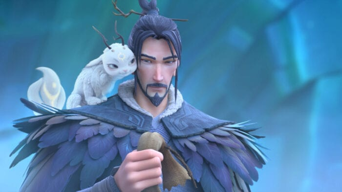 A man wearing a cloack made of feathers has a small mythical dog like creature on his shoulder. They are both looking at theburlap bag the man holds in his right hand.