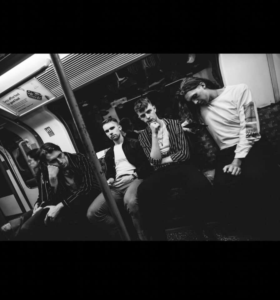 The four male members of the Irish band The Clockworks on the Tube