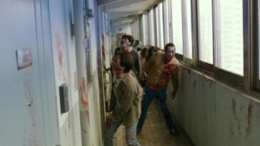Zombies standing in a hallway
