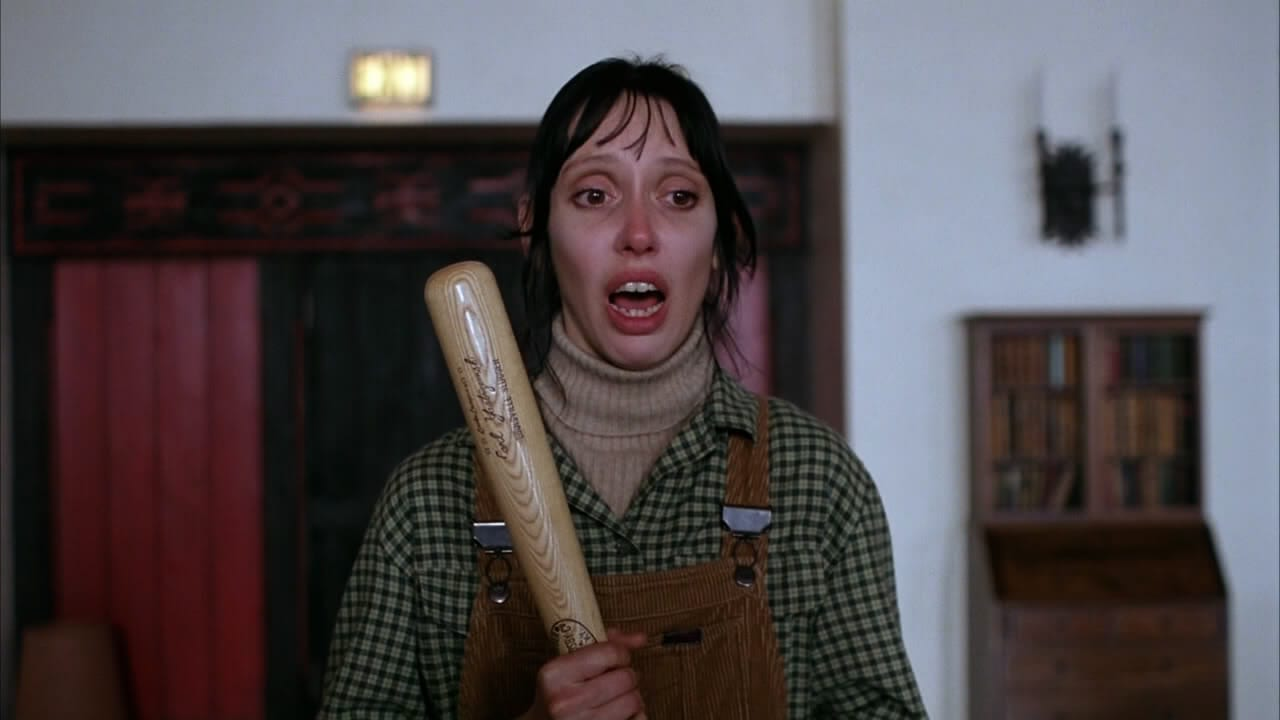Shelley Duvall as Wendy in The Shining, holding a baseball bat