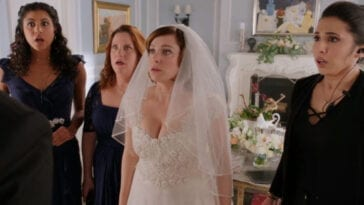 Heather, Paula, Rebecca and Valencia stand in shock, Rebecca in a wedding dress