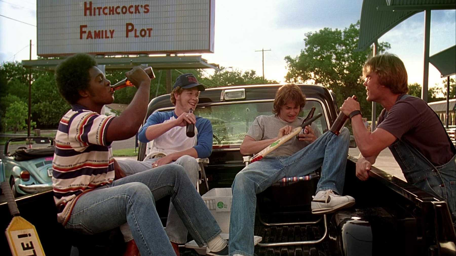 Melvin (Jason O. Smith), Benny (Cole Hauser), Pink (Jason London), and Don (Sasha Jenson) sit in the back of a pickup truck drinking beers and chatting.
