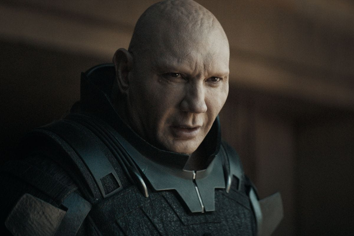 A bald Dave Bautista looks on in the Dune trailer