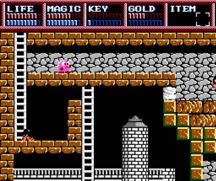 The first dungeon room in Legacy of the Wizard, with a castle tower in the background and monsters