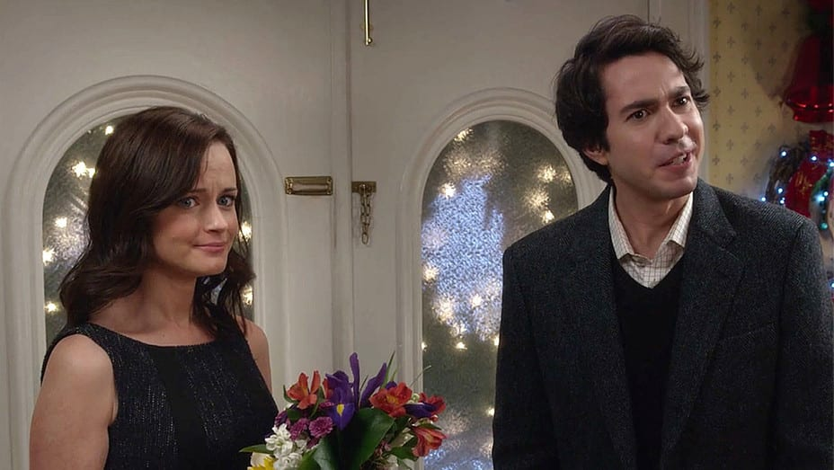 Rory stands with flowers beside her boyfriend
