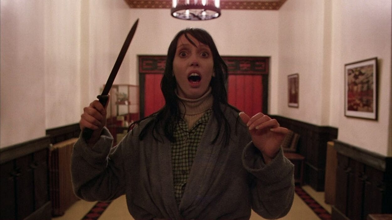 Shelley Duvall as Wendy in Stanley Kubrick's The Shining: she is brandishing a knife