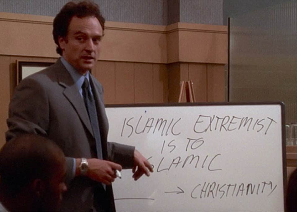 Josh Lyman stands in front of a whiteboard comparing the KKK to Islamic Extremists in Isaac and Ishmael