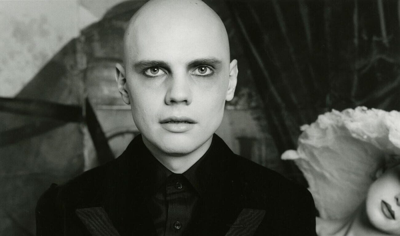Billy Corgan standing in black outfit, staring forward