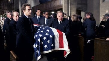 Bartlet, Josh, Santos, and Charlie are pallbearers at Leo's funeral