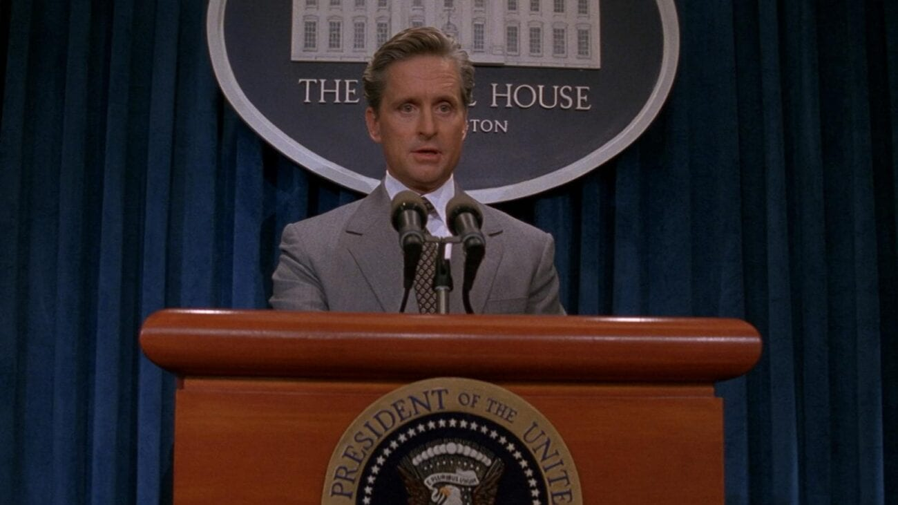 President Shepherd stands at a podium speaking to the White House press corps.