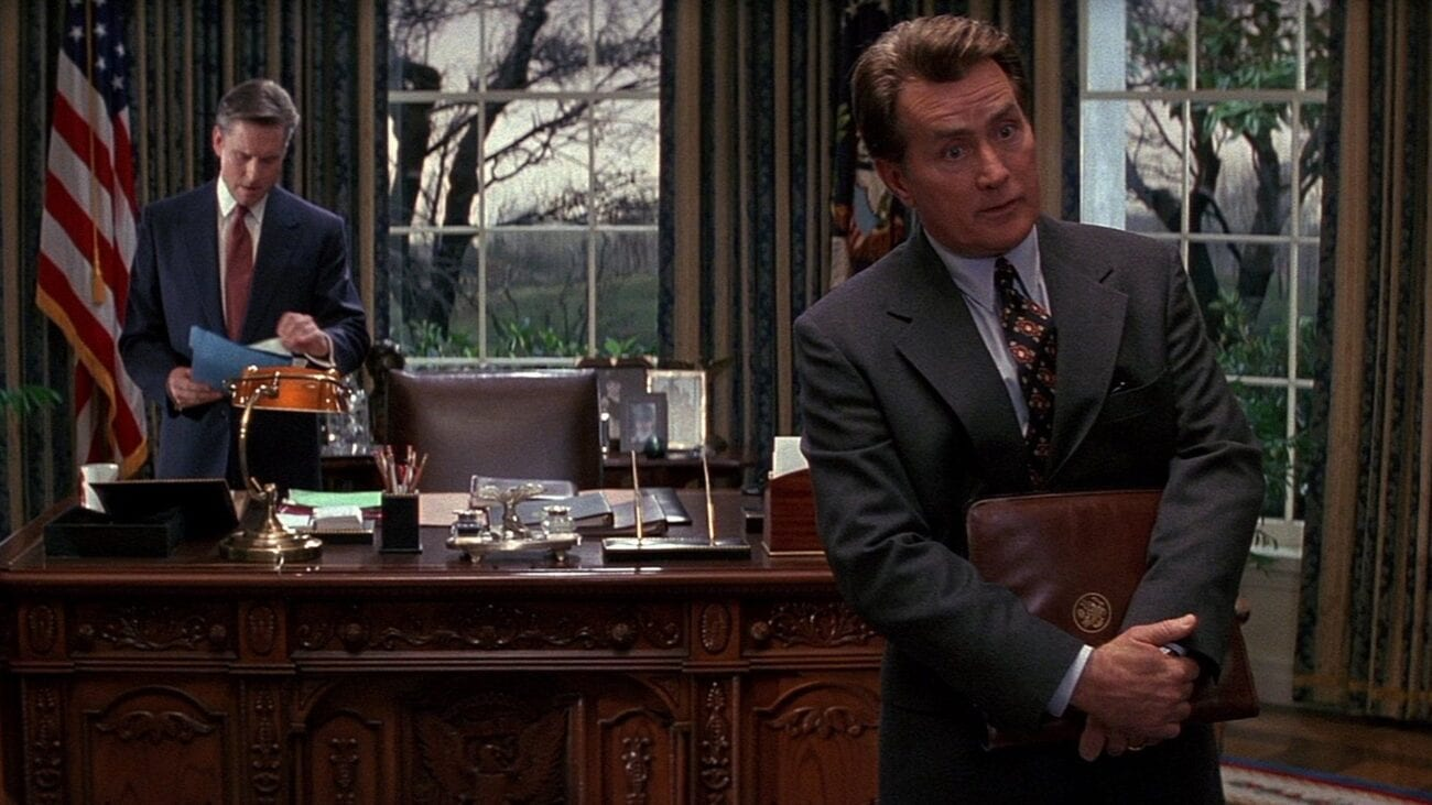 A.J. MacInerney advises a guest addressing the President behind him in the Oval Office.