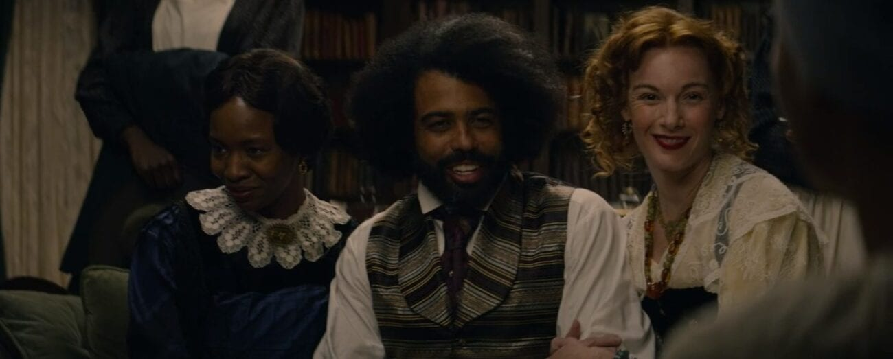 Anna (Tamberla Perry), looking to the left, while Frederick (Daveed Diggs) and Ottilie (Lex King) smile toward the right, as they all sit on a couch arm in arm