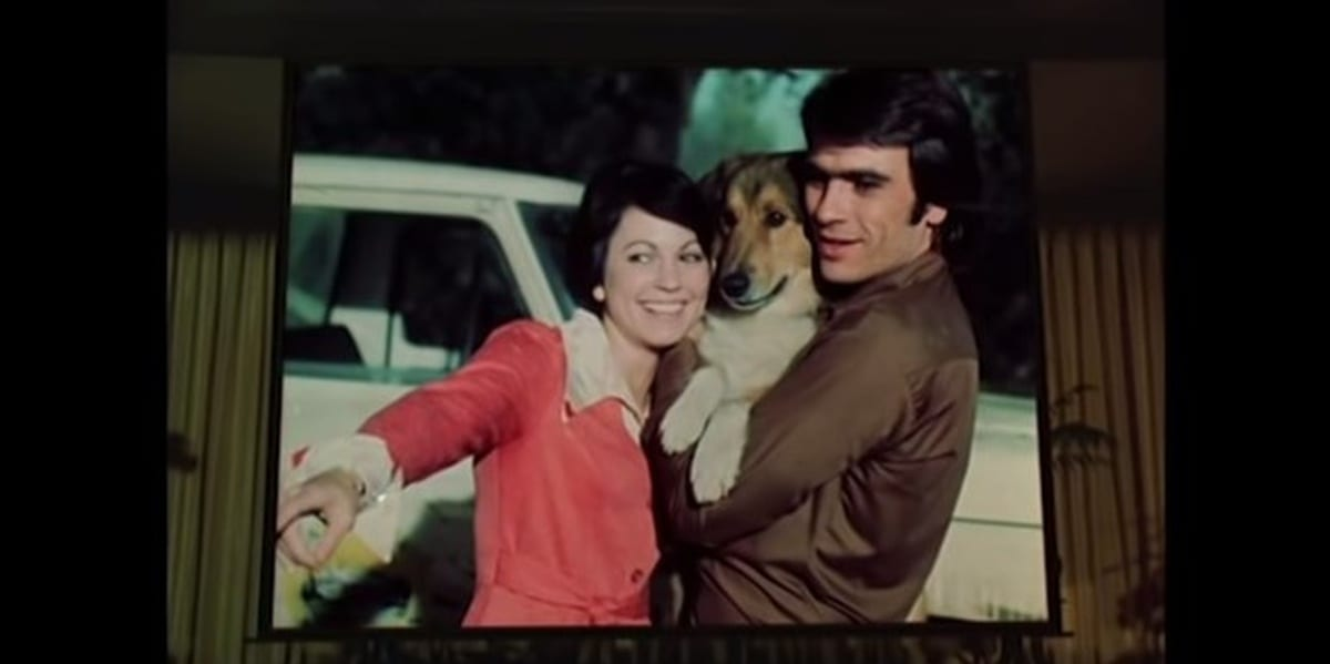Aram and Janet with a dog on a projector in Charlie's Angels pilot episode