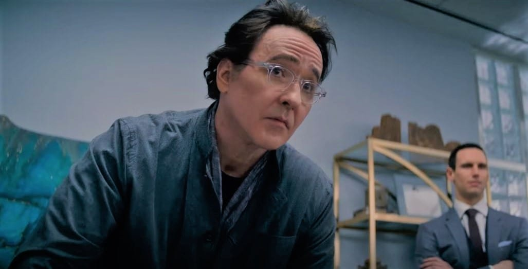 John Cusack as the head of Christie Bios