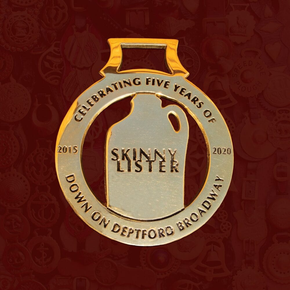 """Image of a flagon with the bands name """"Skinny Lister"""" written on it"""