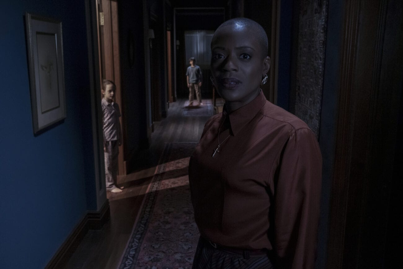 Hannah lurks in a hallway while Miles and Flora stand by their doors.