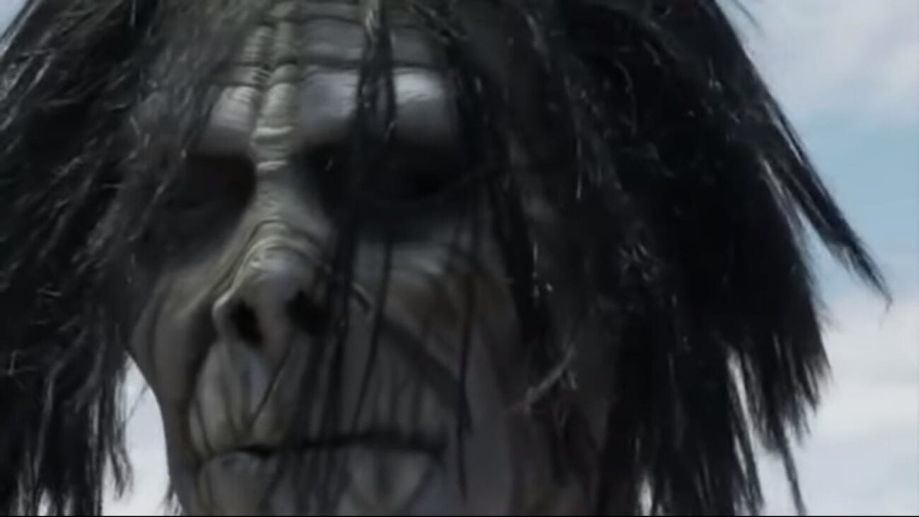 """Neil Breen as """"The Being"""" from I Am Here....Now. Extreme closeup of what appears to be a white zombie or monster mask with wild unkempt hair."""