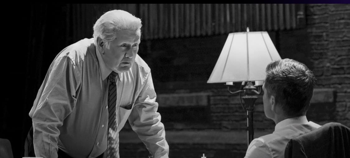 black and white shot of President Bartlet talking to Sam Seaborn over a chessboard