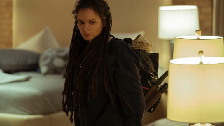 A portrait shot of Jessica Hyde. She is wearing warm clothes and has long dreadlocks
