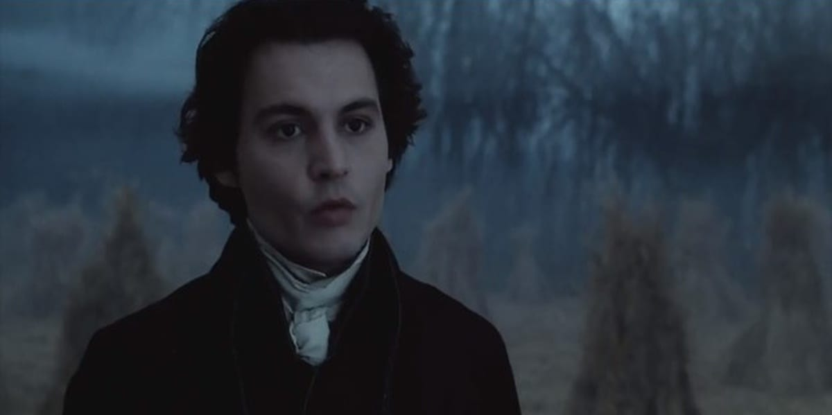 Johnny Depp in Sleepy Hollow with a foggy field in the background