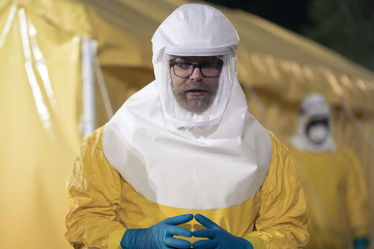 Michael Dugdale kitted out in his hazmat suit at the scene of the field hospital