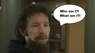 "Neil Breen as Cale Altair from his film Twisted Pair. Breen is wearing a comically bad fake beard and mustache. A speech bubble says ""Who am I?! What am I?!"""